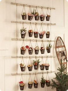 Advent calendar made with small metal pails hanging from branches