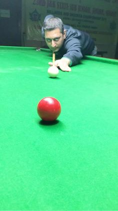 Sohail Khalid aiming at target  during State Senior Billiards Championship.