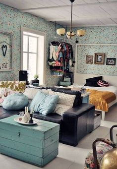 A tiny space can be amped up by turning it into both a vibrant living room and bedroom, with a whole lot of color and pattern.