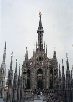 "Dome of Milan, Italy -  famous ""Madonnina"" atop the main spire, a baroque gilded bronze statue"