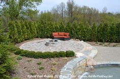 When you build a custom swimming pool, a matching firepit is a great choice. The bluestone on the firepit matches the swimming pool coping, and the stone on the firepit matches the stone on the raised spillover spa and the raised retaining wall/pool wall.    Michigan Custom Hybrid Swimming Pool
