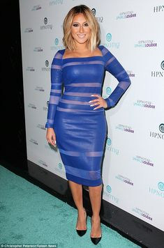 Hypnotic outfit: Adrienne Bailon got the party started at HYPNOTIQ liqueur's Sparkle Louder launch in New York City on Monday