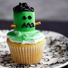 Please your Halloween party guests with these adorable Marshmallow Frankenstein Cupcakes. More Halloween cupcakes: http://www.bhg.com/halloween/recipes/17-frightfully-good-halloween-cupcakes/?socsrc=bhgpin100813frankensteincupcake&page=9