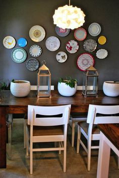 Love this! Collect plates from garage sales, goodwill.... Definitely cheap and chic! I love the way they've used color & pattern with these plates.  I've seen the opposite which is nice, too.  But, with the subtle furnishings, I love this approach!