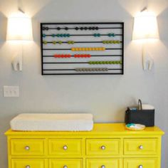 love the toy on the wall- i'd use the idea for a vintage boys room