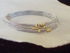 These are selling like crazy! Steel #Guitar String Bangle #Bracelet Trio by beadbooty.etsy.com.