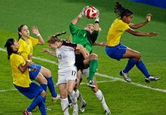 United States' Hope Solo saves a ball by Brazil's Renata Costa, right, as United States' Lori Chalupny (17) defends during their women's soccer gold medal game at the Beijing 2008 Olympics in Beijing Aug. 21, 2008. (Ricardo Mazalan/AP)