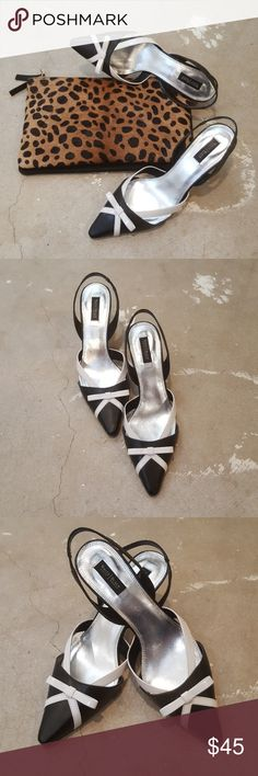 White House Black Market Black Kitten Heels I am selling a chic and classic pair of White House Black Market heels.  Shoes feature a low, comfortable kitten heel as well as an elastic, sling back and a pretty white bow, design,.embellishment.  This particular pair of heels are in excellent condition with hardly any wear on bottom of sole and none whatsoever elsewhere.  Size 8.5. White House Black Market Shoes Heels