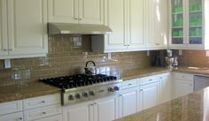 Champagne Glass Subway Tile Backsplash with White Cabinets