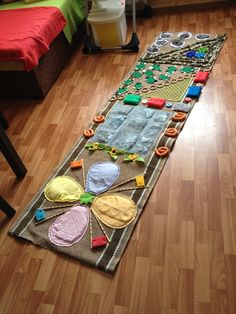 Step by step how this Russian mother made this beautiful forest theme sensory rug. Very little to no money in materials- just a lot of time and love and creativity. A great example of how sensory integration can be beautiful even if done without a lot of money. Notes Ochumelov mom website. comments and pin Gail Zahtz