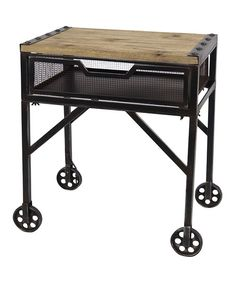 Equal parts form and function, this antique-inspired rolling table brings an industrial edge to any space. A mesh drawer below adds extra storage space, and a wooden work surface is bound to inspire great ideas.22.5'' W x 24.25'' H x 14.5'' DWood / metalAssembly requiredImported