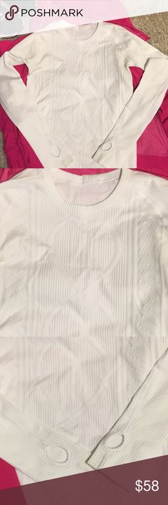 """Lululemon white long sleeve top. Size 6 Lululemon white long sleeve top. This buttery-soft top has a white on white design. Fabric is sweat wicking and soft. Stretching, breathable and sweat-wicking and soft. Has two marks on both sleeves but not noticeable. Picture #4 Size 6 Measurements laying down flat 26"""" shoulder to bottom of sleeve  15"""" across chest  22"""" under arm pit to bottom of sleeve  🌸jacket can be found in my closet for sale. Great combination lululemon athletica Tops Tees…"""