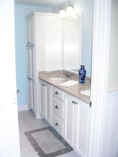 HGTV presents a small, traditional powder-blue bathroom with cottage accents and built-in white cabinetry.