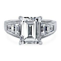 This solitaire ring with side stones combines striking details and undeniable radiance to make you feel truly glamorous. Made of rhodium plated fine 925 sterling silver. Features 3.79 carat emerald cut cubic zirconia (10mm x 8mm) in 4-prong setting. Accented with 1.09 ct.tw tapered baguette cut cubic zirconia in channel setting. Band measures 2.5mm in width. Nickel free.