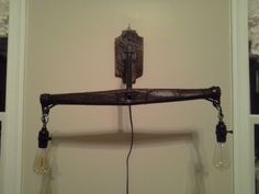 Rustic Homemade Hanging Wall Hame Light with Piping and Vintage Bulbs