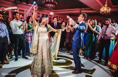 Cheerful indian couple rocking the dance floor http://www.maharaniweddings.com/gallery/photo/135504