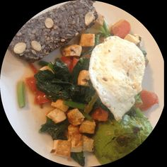 My Saturday breakfast, most anticipated meal of the week :) Spinach, tomatoes, tofu, avocado and a runny egg. And nutbread. Deliciouuuus!