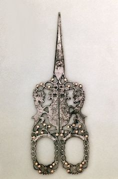 Scissors emblazoned with Cavendish arms, English (Sheffield), c.1840 / Victoria & Albert Museum, London, UK / The Bridgeman Art Library.