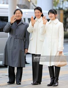 Crown Prince Naruhito, Crown Princess Masako and their daughter Princess Aiko wave to well-wishers on arrival at the JR Nagano Station on March 22, 2016 in Nagano, Japan.