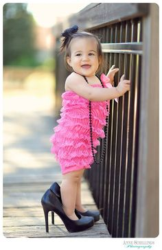 one year old pettiromper high heels necklace pearls necklace pink black outdoor portrait photo session birthday girl baby cake smash park lace studio picture https://www.facebook.com/anneschillingsphotography www.thehairbowcompany.com   https://www.facebook.com/anneschillingsphotography