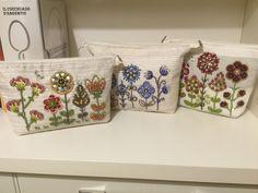 Pochettes con applicazioni in bead embroidery