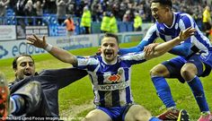 Last gasp: Chris Maguire (centre) celebrates his injury time winner for Sheffield Wednesday against Barnsley