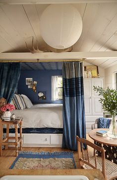 Love this cozy bed nook with wallpapered ceiling kellyelko.com Black Window Trims, Beach Houses For Rent, Bed Nook, Cottage Interiors, Cottage Bedrooms, Cottage Living, Tiny Living, Blue Wood, Wood Ceilings