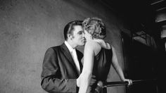 """This June 30, 1956 photo provided by courtesy of Taschen shows, """"The Kiss,"""" at the Mosque Theater in Richmond, Va. The image is Wertheimer's most iconic photograph, and the identity of the woman was unknown until she came forward in 2011. The photograph is included in the book, """"Elvis and the Birth of Rock and Roll, """" by author/photographer, Alfred Wertheimer, published by Taschen. Wertheimer, the photographer whose portraits of Presley documented the birth of a music legend, has died. He…"""
