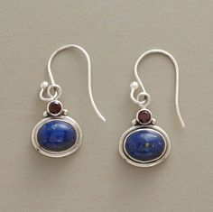 """The color of loyalty, the hue of passion: A true blue lapis cabochon topped with a faceted garnet. Handcrafted in sterling silver with French wires. Sundance exclusive. 1-1/4""""L."""