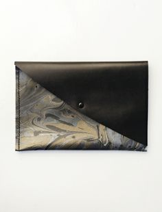 c772185f3231e4 Ann-Ya marbled leather clutch from Cisthene