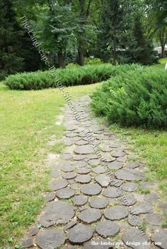 log rounds turned into garden pavers and pathways. YES.