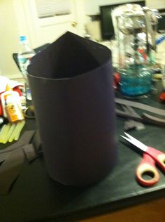 Step 1 take poster board and fold into shape of crown and staple/glue/tape together. Trim of excess hat as needed.