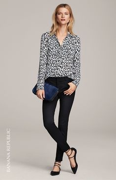 Add an ultra feminine touch to your look with our black and white print ruffle detail blouse. Pair this top with slim fitting pants and chic flats for the perfect desk to date look | Banana Republic