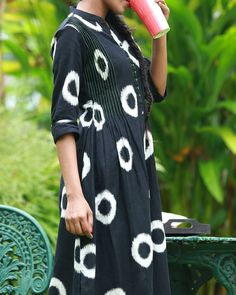 Black ikat kurta with white geometric designs. Mandarin collar and centre front placket with buttons. Green facing with stitchline detailing on hemline
