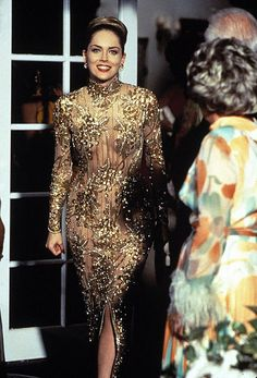 1995 Iconic Sharon Stone Casino Gold Sequin Beaded Illusion Gown By Bob Mackie  Fashioned in a seductive nude embroidered net, the beaded and sequin grapevine designs carefully cover the body in such a skillful way.