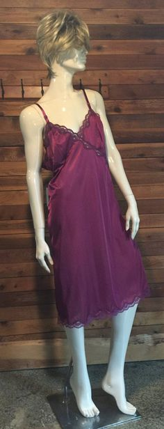 Vintage MOVIE STAR Burgundy Full Slip Size is 38 Color is Burgundy 100% Nylon Adjustable Straps Armpit to armpit 19 Waist 34 Hips 40 Length from the underarm 32 50 Sweep 16 Slit Made in USA Excellent Condition FREE PRIORITY SHIPPING in the U.S.  Inv # 8010