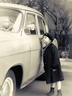 Cute little girl dressed in retro coat posing near oldtimer car - Cute little girl dressed in retro coat posing near oldtimer car, sixties