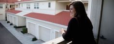 Katy Howser, a kindergarten teacher in the Santa Clara School District, looks out from the balcony of her apartment. (AP)