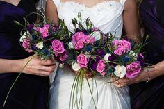 Aqua rose, Avalanche rose, beargrass, eryngium thistle and purple eustoma bouquets