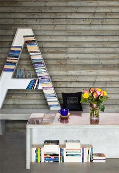Wood wallpaper and oversized A bookcase