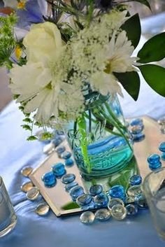 Mason jar with white flowers and glass gems