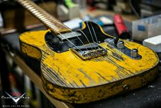 True Grit.  Gorgeous worn Tele up on cinder blocks... No sugar-coated fluff comin' outta this fretboard.
