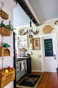 Christmas Home Tour - A Delightsome Life- in the kitchen the Scarborough nesting crates filled with colorful Christmas decor...