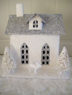 DIY Glitter Houses. I typically hate glitter but I love the look of these for winter fantasy wedding centerpiece or side table decoration.