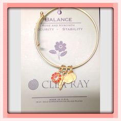 18 Kt. Gold dipped bracelet. Rose and Hyacinth Charm  to help maintain Security and Stability.