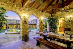 Beautiful stone patio looking out over the spacious spa pool at a beautiful California mansion home.