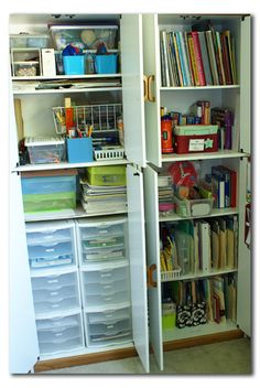 Who new how much you could store in just two cabinet. Great idea for organization, and you could paint them to make them even more fun!