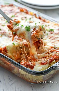 Sour Cream Noodle Bake Recipe is loaded with ground beef, smothered with 3 different types of cheese and pasta sauce all baked together to create a delicious combination that may just top your favourite lasagna recipe!