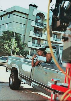 Tupac Shakur wildin' out a pickup truck.