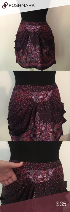 "Anna Sui For Anthropologie Silk Floral Skirt Sz 10 Stunning silk skirt from Anna Sui got Anthropologie. Purple Floral design and it has pockets! Size 10.  Waist- 35""  Length- 17""  I generally include a small bag of lavender in with my items, please let me know if you do not want this. All items come from a smoke free home!  Offers are welcome, I will either accept or counter. Please let me know if you have any questions or need further measurements. Anthropologie Skirts Mini"